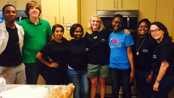 Members of the Peacemakers service organization with sponsor Rose D'Alessio as they prepare to serve dinner to cancer patients at Lee Griffin Hope Lodge in Birmingham. (Contributed)