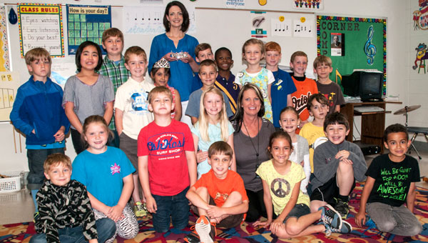 Dr. Deidre Gunn - formerly Deidre Downs - surprises Ashley Wentworth's class at Helena Elementary School during a recent visit. (Contributed)