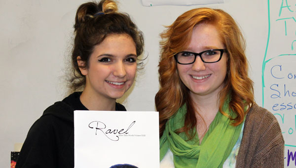 Sarah Sansom and Maggie Smith display this year's Pelham High School Literary Magazine. (Contributed)