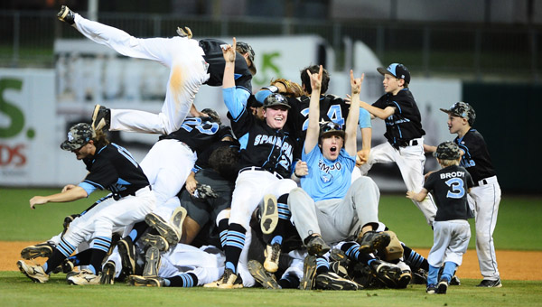 The Spain Park High baseball team celebrates after capturing the first AHSAA 6A State Baseball Championship in school history. (Reporter Photo/Jon Goering)