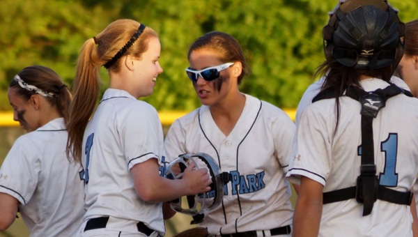 Members of Spain Park's softball team congratulate pitcher Julie Knight after a win against Pelham May 1. (Contributed/Tim Knight)