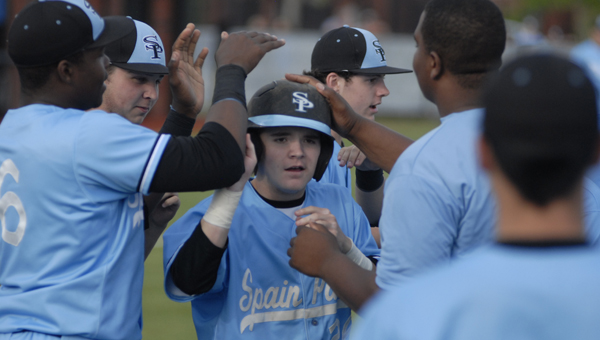 Spain Park's Collin Walker is congratulated by teammates after scoring the opening run of a 9-0 win over Northview May 2. (Reporter Photo/Drew Granthum)