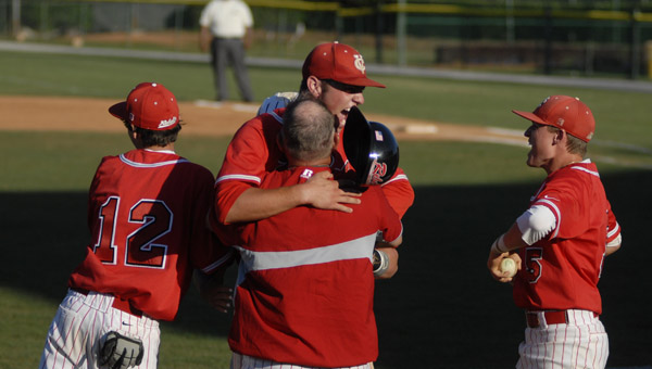 Coosa Valley head coach Bobby Permeter hugs Colton Pate after Pate tossed a no-hitter in game one of the AISA baseball state championship. (Reporter Photo/Drew Granthum)