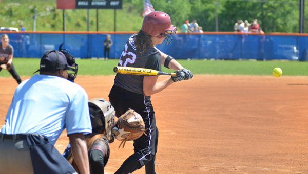 Shelby County pitcher Kaitlyn Paschall swings at what became a lead-off home run in the AHSAA Class 5A Area 8 tournament May 2. (Contributed/Stephen Dawkins)