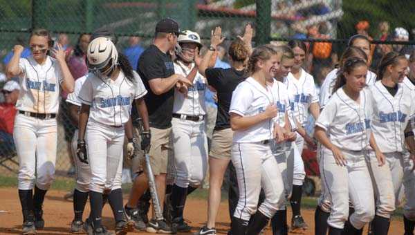 Members of Spain Park's softball team congratulate M.K. Bonamy after a home run in a state championship elimination game May 17. Unfortunately the Jags fell in extra innings, 5-4. (Reporter Photo/Drew Granthum)