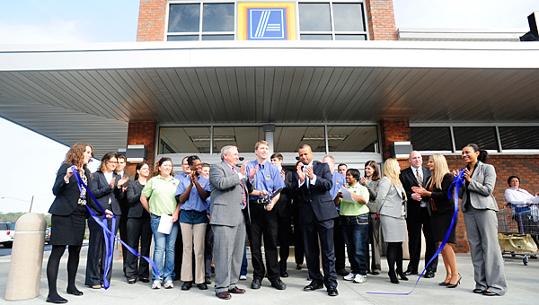 Store and city officials celebrate the opening of the Pelham Aldi store in 2011. The company is planning to build a new store at the intersection of U.S. 31 and Shelby County 11. (File)