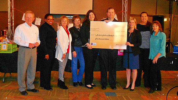 The Birmingham Chapter of Women of AT&T present a $5,000 check to the Back Pack buddies program. (Contributed)