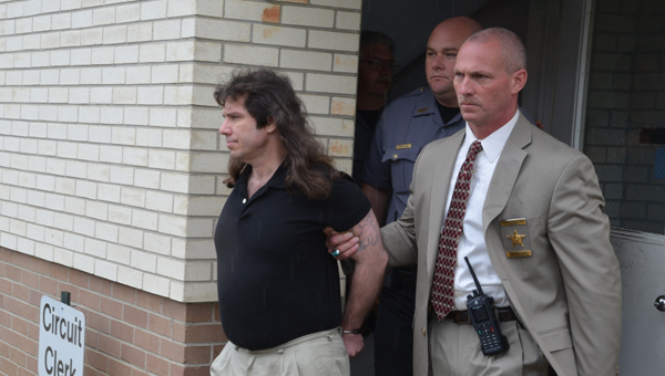 Chilton County jurors found James Osgood guilty on two counts of capital murder May 9. Officers with the Chilton County Sheriff's Department escorted Osgood (left) out of the courthouse in handcuffs.