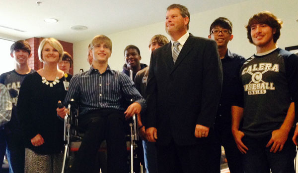 Calera high school student Evan Majewski demonstrated the lifting wheelchair designed by students in Brian Copes' class at the unveiling on May 15 (Ginny Cooper/For the Reporter)