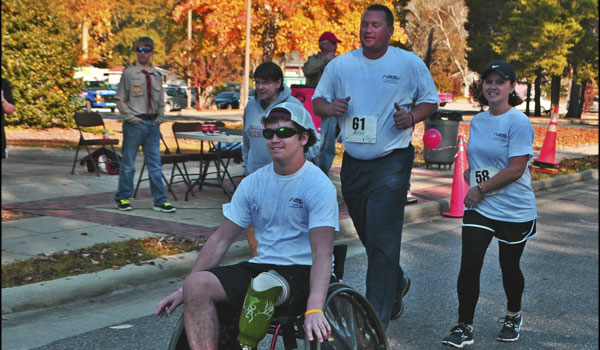 Chris Goodwin during the first annual Never Ever Give Up Race, followed by his mother and father. (Contributed)