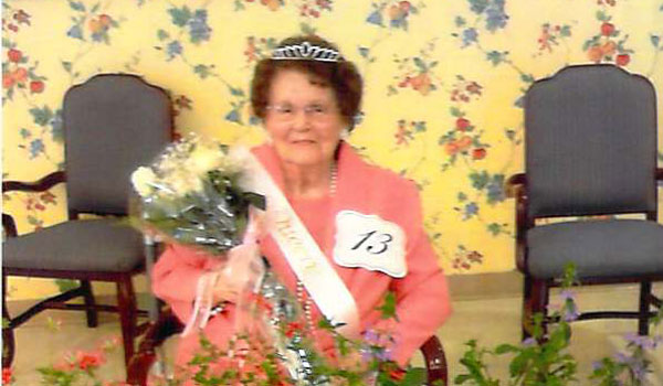 Mildred Baldwin, winner of the Columbiana Health and Rehab Queen pageant, surrounded by pageant. (Contributed)