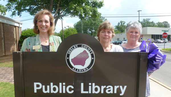 Columbiana Public Library Executive Director Dutcha Lawson, Circulation Manager Sheila Gallups and library staff member Agnes Pool in front of the Columbiana Public Library on Lester Street. (Contributed)