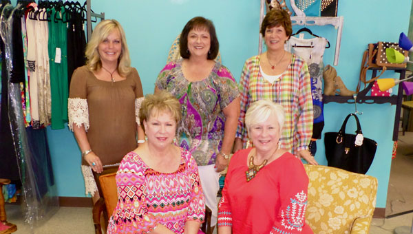 Front row from left, Kayren Owens and JoEllen Ramsey and back row from left, Kristi Watts, Tammy Keener and Beth Menke from Helena's Sassy Sisters boutique all helped put together a gift basekt for A.J. McCarron and Katherine Webb's July 11 wedding. (Reporter Photo / Molly Davidson)