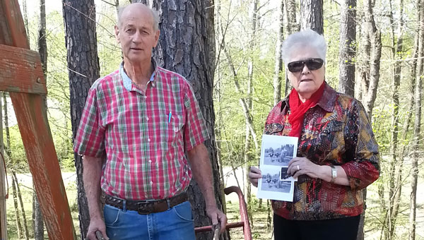 Donald Shirley, left, shows off grandfather's plows donated with historic picture healed by Juanita Champion. (Contributed)