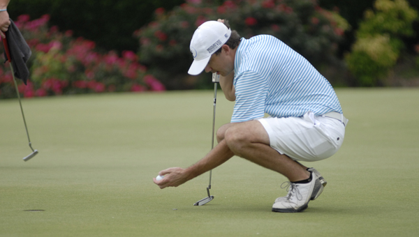 Former Spain Park and Auburn golfer Travis Grote places his ball as he studies Hole 18 at the Greystone Invitational June 19. (Reporter Photo/Drew Granthum)