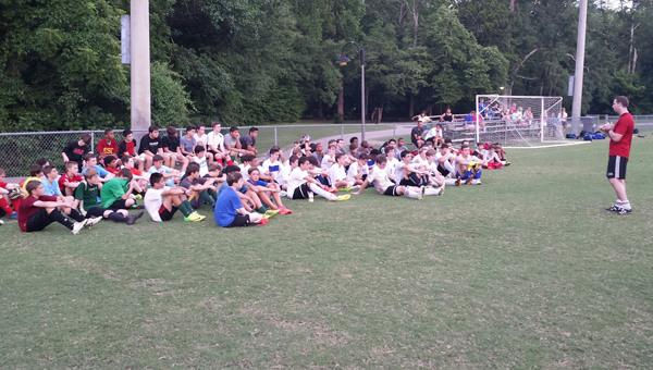 Participants of the North Shelby Soccer Camp listen as an instructor informs them of the college recruiting process. (Contributed)