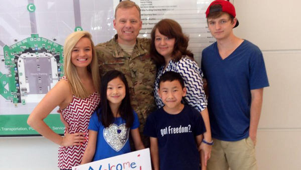 Terri Stricklin with children, Bethany, Aubree Lu, Andrew and Zach (left to right) greet their father Col. Chris Stricklin upon his arrival from Afghanistan. (Contributed)
