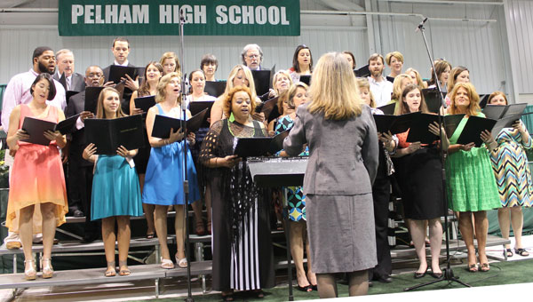 Lynne Jebeles directs the Pelham High School faculty choir for her last graduation before retirement. (Contributed)