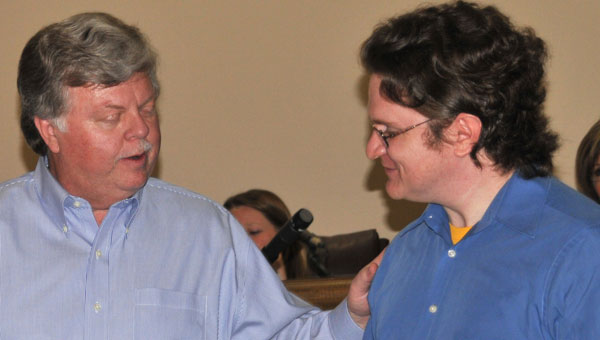 Mayor Mark Hall presents Samuel Kent with a Certificate of Commendation as Poet Laureate of Helena 2014. (Contributed)