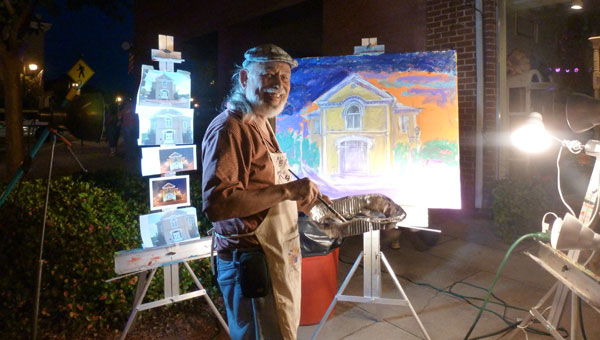 Jerry Roldan paints the Shelby County Old Courthouse at Music on Main as a benefit for Shelby County Arts Council. (Contributed)