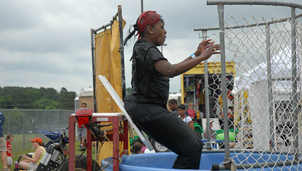 Thompson Intermediate School Principal Dr. Ke Jones is dunked during last year's CityFest. The booth will return this year beginning at 10 a.m. (File)