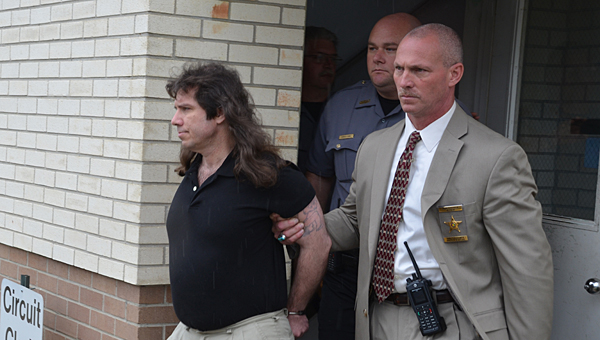 Shelby resident James Osgood, left, is led from the Chilton County Courthouse during his murder trial in May. (File)