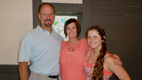 Kimberly Tapp (center), picutred with her husband and daughter, opened Polished, a new nail salon in Old Town Helena, with a ribbon cutting ceremony on June 11. (Reporter Photo / Molly Davidson)