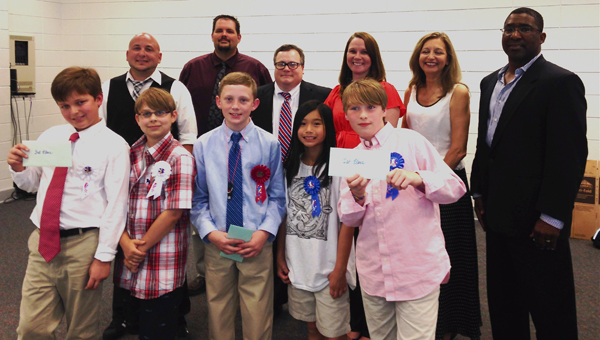 Winning inventors of Helena Intermediate School's Shark Tank posed with the local business leaders who judged the competition on May 20. (Contributed)