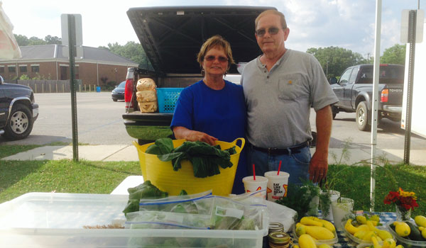 Sandra and Robert Armstrong with R & S Farms sold hydroponic lettuce, herbs and a variety of other vegetables at the first farmer's market of the season in Calera. (Ginny Cooper/Reporter Photo)