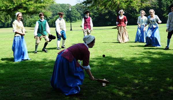 Junior Interpreters play Colonial games on the green. (Jon Goering/Reporter Photo)