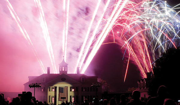 Spectators watch as fireworks light up the sky during the Independence Day 1776 celebration at American Village in Montevallo on a past July 4. (Reporter Photo/Jon Goering)