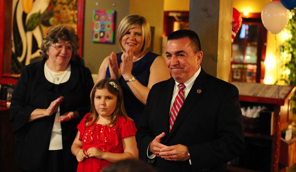 John Samaniego with his family after his win in the June 3 elections. (Jon Goering/For the Reporter)
