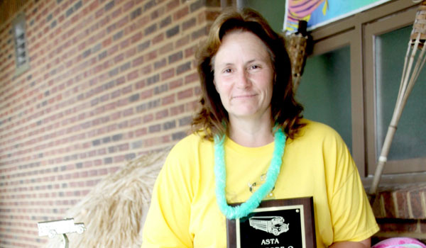 Rhonda Kendrick displays her plaque and trophy she received as the state champion at the Alabama School Transportation Association School Bus Safety Road-E-O. (Contributed)
