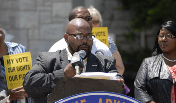 Shelby County NAACP President Rev. Kenneth Dukes speaks at a June 25 press conference held to commemorate the one-year anniversary of the Shelby County v. Holder ruling (Reporter Photo/Drew Granthum)