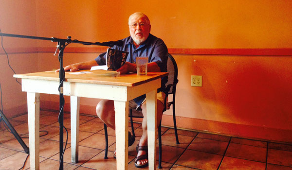 """William Cobb reads the prologue from his newest novel, """"A Time to Reap"""" during a June 25 book signing at Eclipse Coffee and Books in Montevallo. (Ginny Cooper McCarley/Reporter Photo)"""