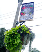 CUTLINE: Hanging baskets planted and hung by the Helena Beautification Committee earlier this summer, now have grown into their full summer beauty throughout the Old Town area. (contributed)