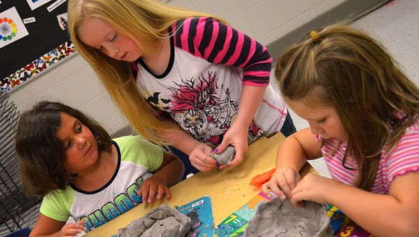 Attendants of Montevallo Elementary School's first ever summer Art Boot Camp during the creation of their plaster casters. (Contributed)