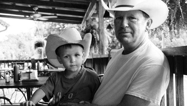 George Webster, owner of Stables of Alabama, and his son, George, always enjoy eating out on the porch at The Depot. (Contributed)