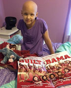 Mollie Wilder sitting in her home where she recently received a care package from the Mrs. Sarah Patterson and the Alabama Gymnastic Team. (Contributed)