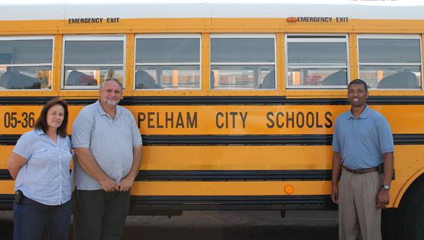 Pelham City Schools bus drivers Rhonda Kendrick and T.J. Dunaway with Pelham City Schools' Transportation Coordinator Floyd Collins prepare get Pelham City Schools' buses on the road. (Contributed)