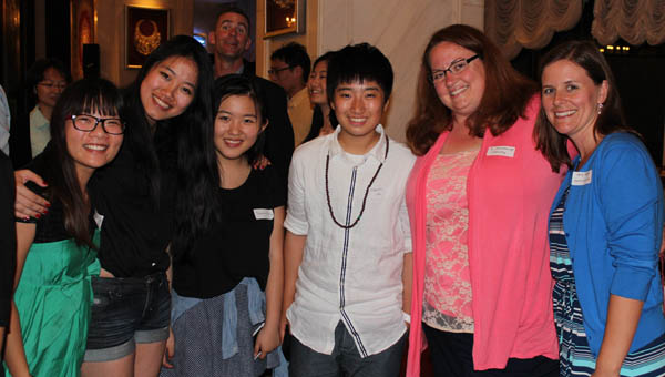 ISS students Sherry Ge, Vivian Wei, Sunny Dong and Claudia Choi stand with chemistry teacher Chris Tetzlaff and dorm parent Holly Rodgers during a reception in Shanghai. (Contributed)