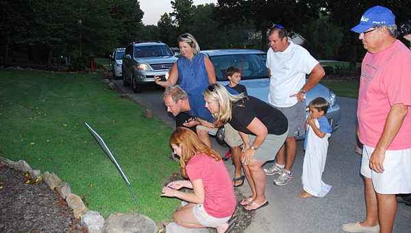 Saddle Lake Farms residents react as the results of an annexation election are posted at the neighborhood's poling place on July 29. (File)