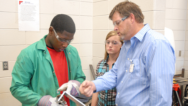 Calera teacher Brian Copes (right) is preparing to kick off the engineering program at Thompson High School for the 2014-2015 school year. (File)