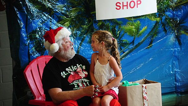 Santa speaks with a member of the Alabaster YMCA during the branch's Christmas in July event on July 25. (Reporter Photo/Jon Goering)