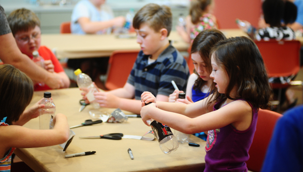 The Albert L. Scott Public Library in Alabaster has hosted the children's Glad Scientist Club, a combined reading and science club, from June 5 through July 10. (Reporter Photo / Jon Goering)
