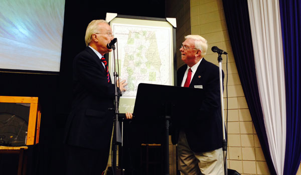 Alabama Director of Tourism Lee Sentell gives an 1833 map of Alabama to Bobby Joe Seales, president of the Shelby County Historical Society (Reporter Photo/Ginny Cooper McCarley)