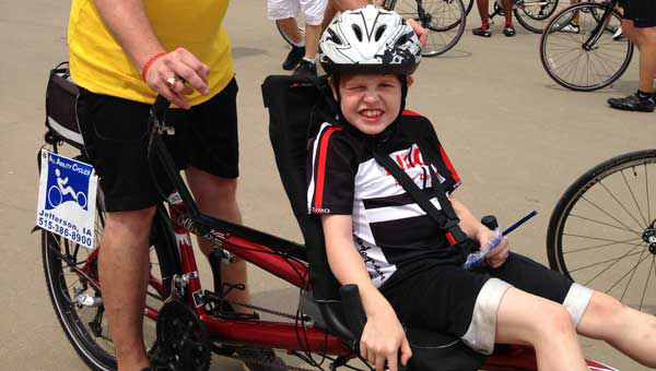 Gabe Griffin rides with his dad, Scott Griffin.  This bike was designed especially for Gabe so that he could participate in the cross country Ride 4 Gabe Fundraiser. (Contributed.)
