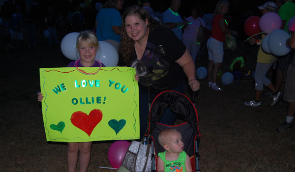 Riley Fletcher, her mother and little brother marched to support Ollie Tetloff (Reporter Photo/Ginny Cooper McCarley)