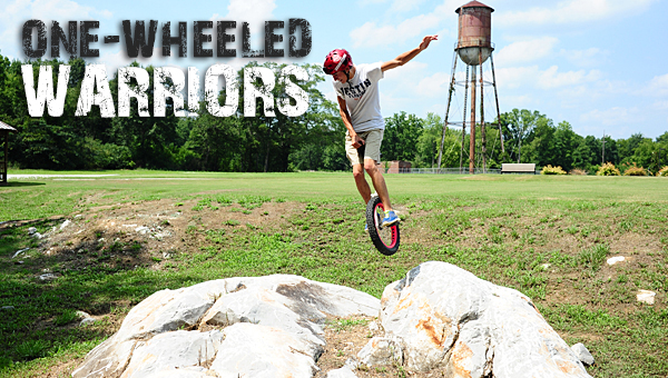 Local unicyclist Will Streets jumps over a boulder at Alabaster's Buck Creek Park. (Reporter Photo/Jon Goering)