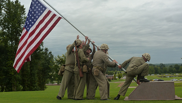 The Howlin' Mad Smith Detachment, Marine Corps League reenacted the raising of the U.S. Flag at Iwo Jima at the Spirit of '45 Day at the Alabama National Cemetery in Montevallo. (Contributed)